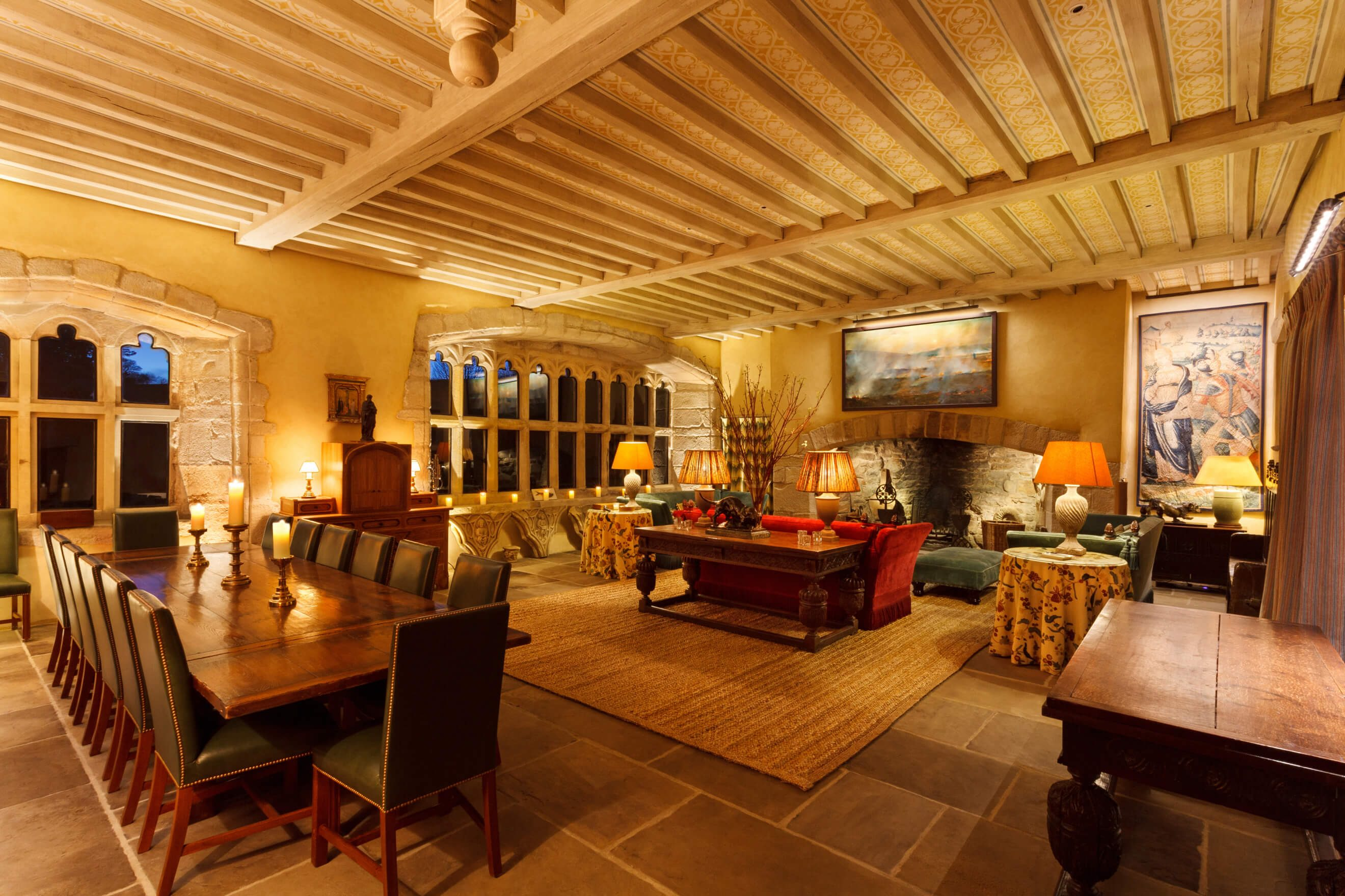 Medieval hall with uplights, candles, artwork lighting and table lamps