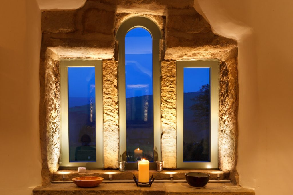 Lighting the stone mullions and cill with custom track mounted LED fittings
