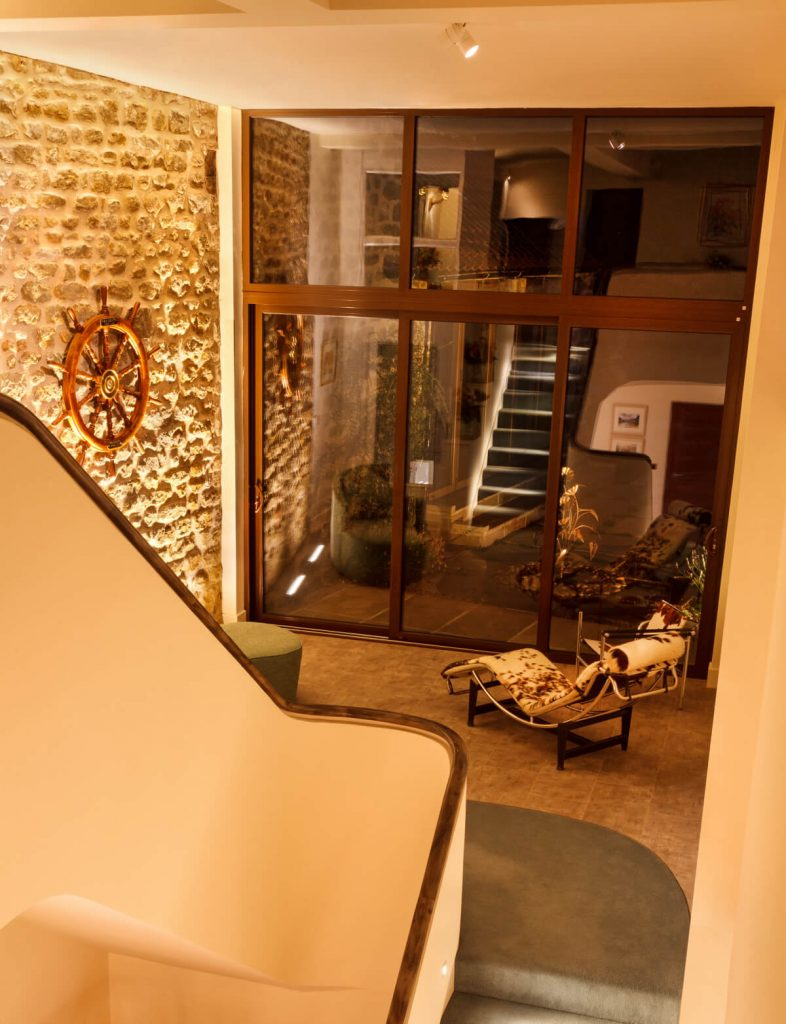 Lighting an internal stone wall, staircase and landing