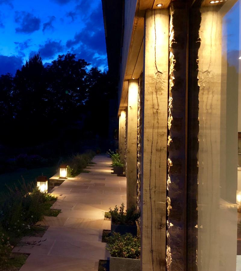 Path lighting with timber pillars and external lanterns