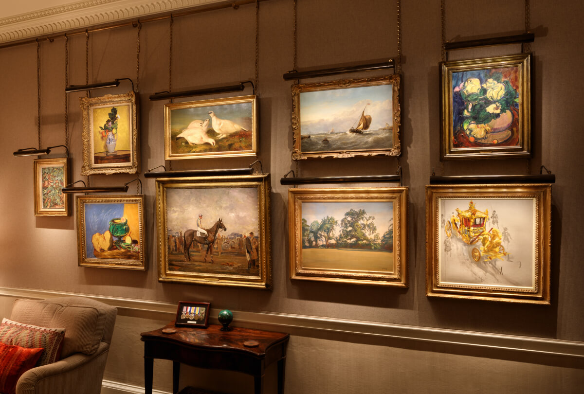 Private Art Collection lit with bespoke ArtView picture lights on hanging rail system