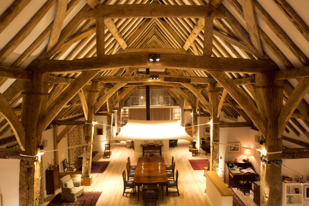 Looking down on the dining area and lit sail in a glorious old barn