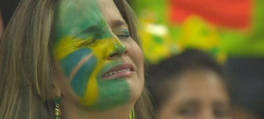 Brazil fan crying on the beach