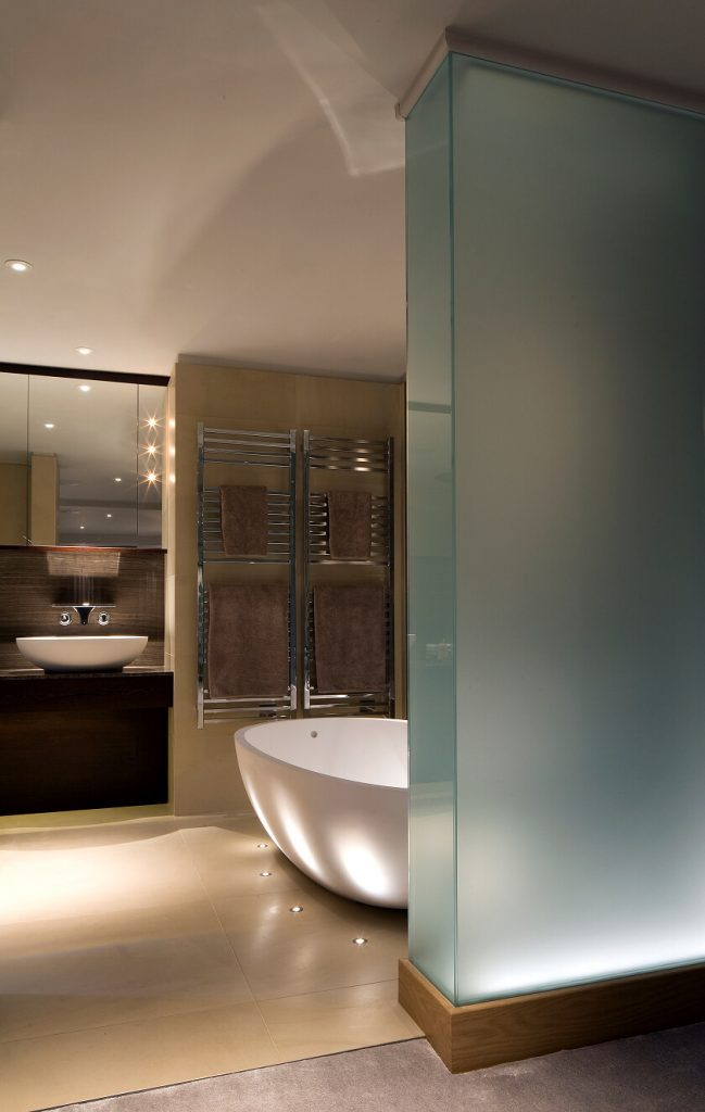 MIrror lighting and ground recessed LED accent lights in a modern bathroom