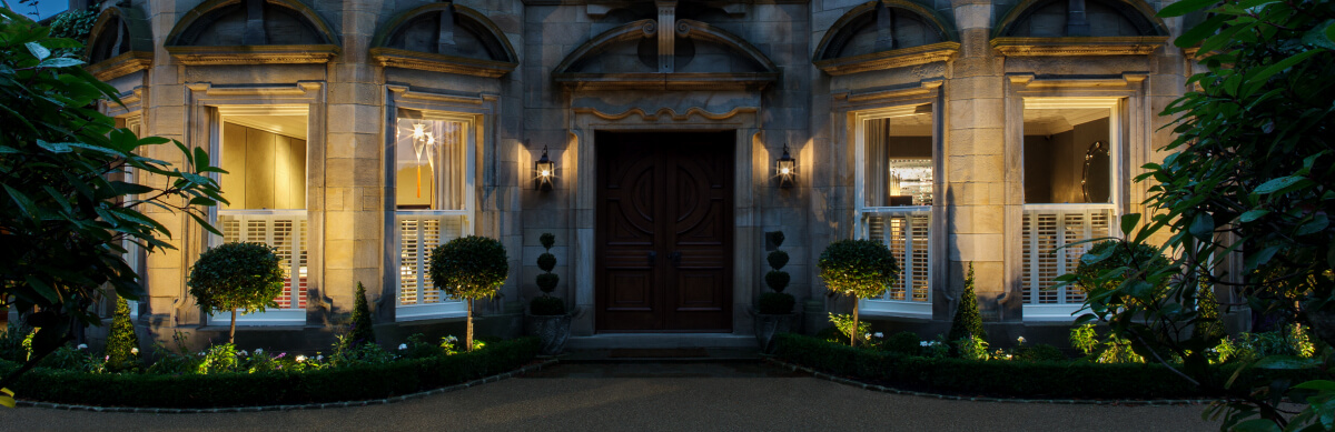 Lighting the front of an Edwardian villa with lighitng in the soft planting