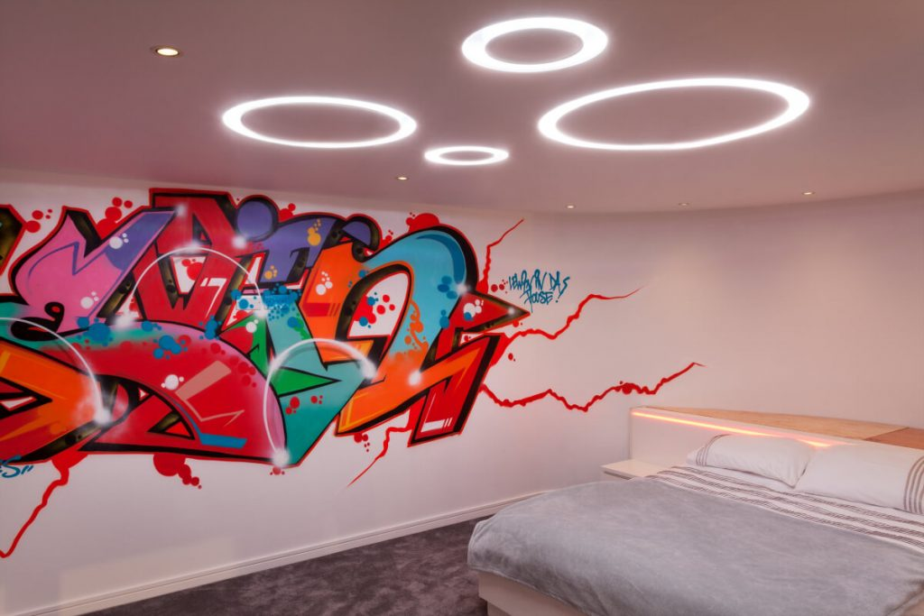 Teenage bedroom with bespoke graffiti and circular LED ceiling lights
